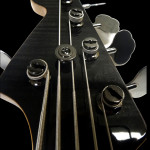 Headstock closeup, 5-string 24-fret bass guitar