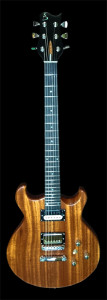 Solid Mahogany body electric. Bend Siniter's guitar player Joseph is it's proud owner.
