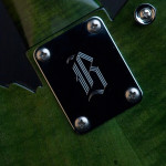 Pot leaf guitar, neck joint plate close up with Basones old logo, handcrafted in Vancouver Canada