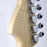 Mini electric guitar, strat shaped, flamed maple neck and headstock