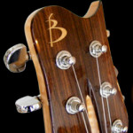 Custom Tele shaped electric, rosewood headstock veneer with Maple logo inlay