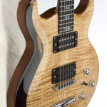 Carved double cut-away solid Honduran Mahogany body with flame Maple carved top, featuring custom Indian Ebony bevel.