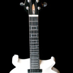 Ebony headstock, Double cut-away solid Alder body, carve top . Arctic White finish.