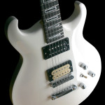 Double cut-away solid Alder body, carve top . Arctic White finish.