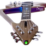 Military-grade laser on headstock, with On OFF mini switch. Completed in 2008