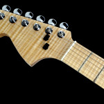 Left handed strat shaped custom guitar, headstock detail with Basone logo, flamed Maple neck, fingerboard and headstock veneer.