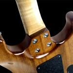 Lefty strat shaped custom guitar, solid mahogany body, natural finish. neck joint detail