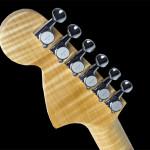 Left handed strat shaped custom guitar, back of headstock, flamed Maple neck, fingerboard and headstock veneer.