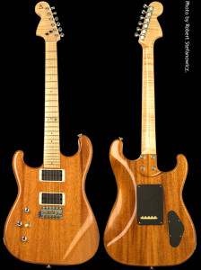 Custom left-handed strat shaped electric guitar, solid mahogany body, natural finish.