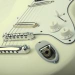 3/4 size electric guitar, Strat shaped, Alder body. white finish
