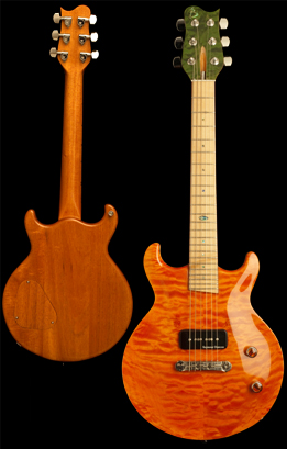 Scaled-down custom electric guitar, Honduran Mahogany body with carved quilted Maple top, Maple fingerboard and binding. Trans orange finish, trans green headstock veneer.